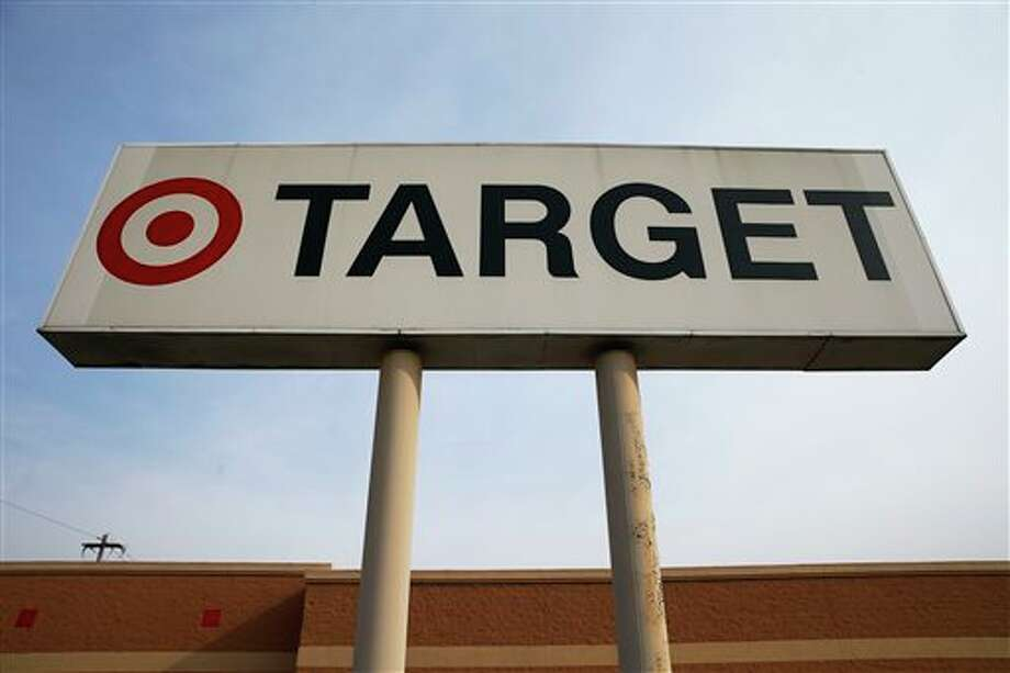 In this Tuesday, March 25, 2014 photo, a sign outside a Target store in Philadelphia is shown. Target said Monday, May 5, 2014, that Chairman, President and CEO Gregg Steinhafel is out, nearly five months after the retailer disclosed a massive data breach that hurt its reputation. The nation's third-largest retailer says Steinhafel has agreed to step down as the company's chairman, president and CEO, effective immediately. He also has resigned from its board of directors. (AP Photo/Matt Rourke) Photo: Matt Rourke / AP
