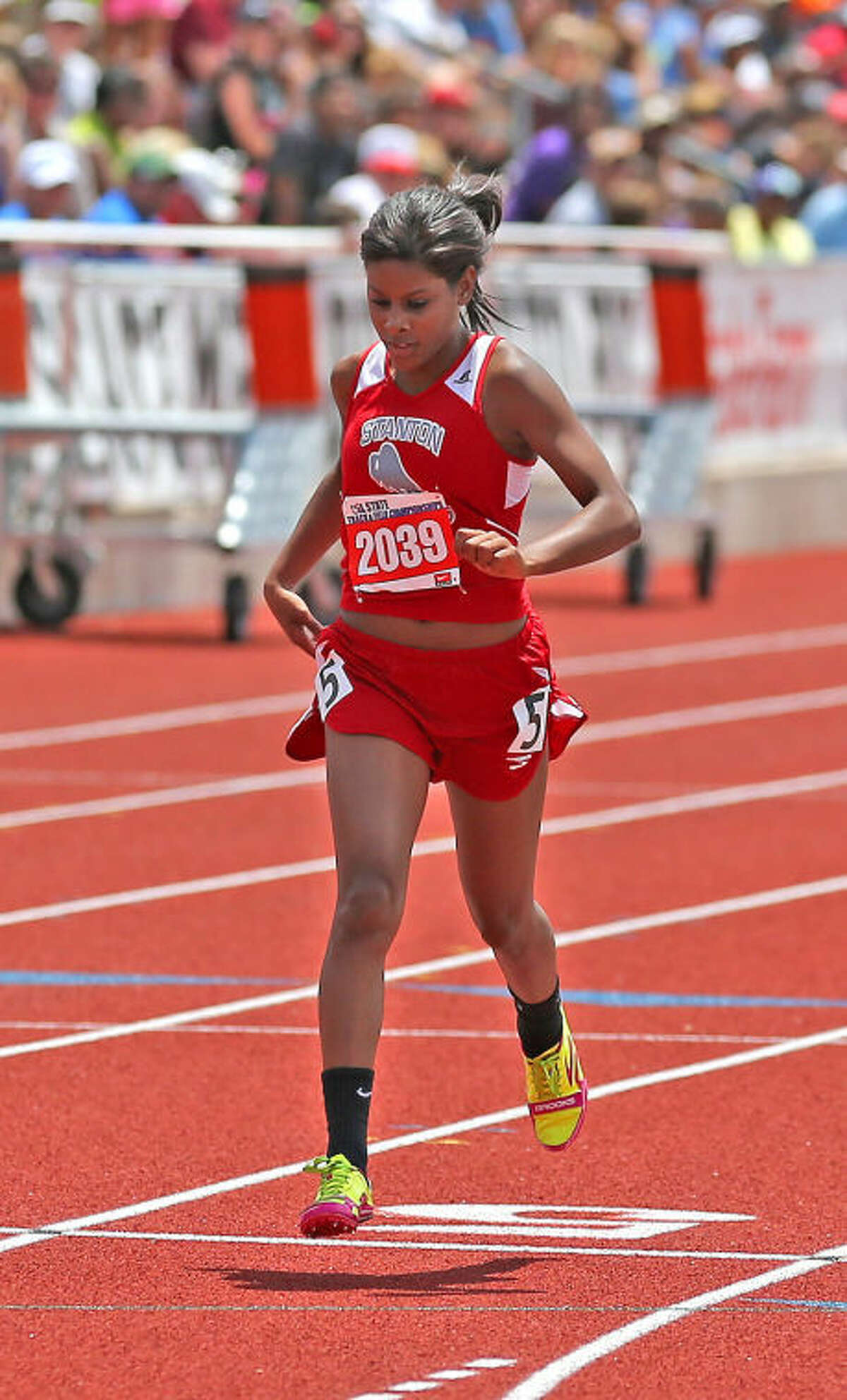 Stanton's Latricieia Smith finsihes the 400 meter dash at the UIL Track and Field Championships on Saturday in Austin.