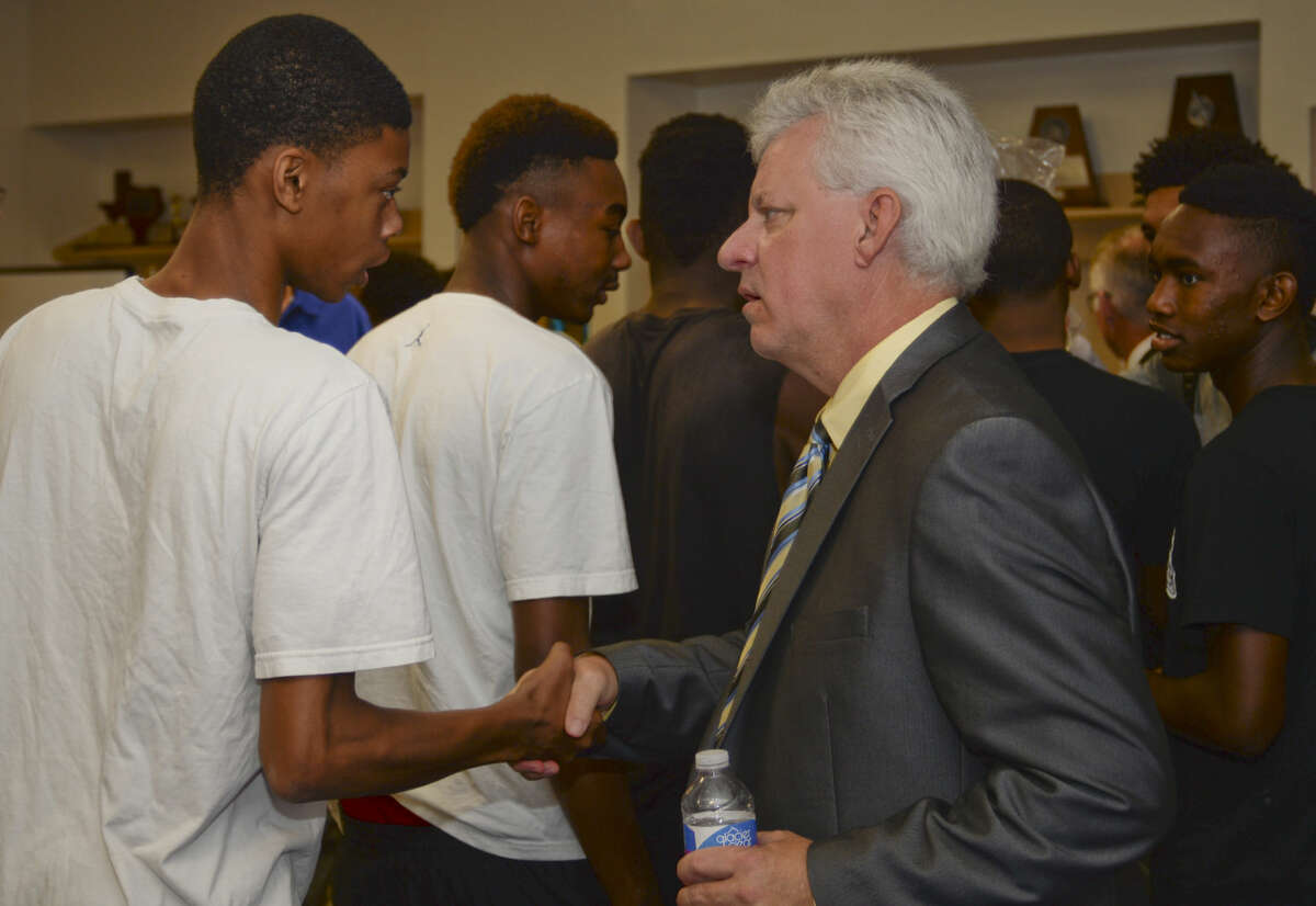Midland High new boys basketball coach Shannon Hooker meets players Thursday, 6-25-15, after being being announced to players and supporters. Tim Fischer\Reporter-Telegram