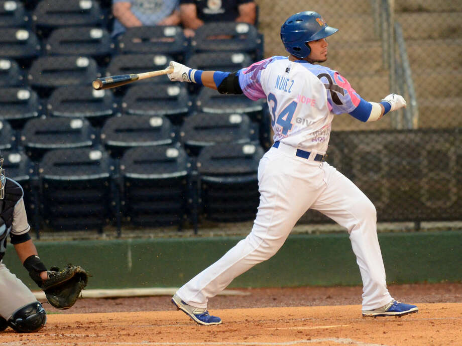 Rockhounds' Renato Nunez swings against Corpus Christi on Friday, June 12, 2015 at Security Bank Ballpark. James Durbin/Reporter-Telegram Photo: James Durbin