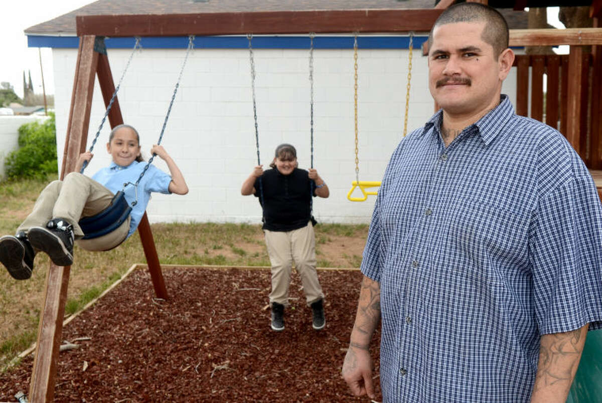 Rudy Ceja is raising his daughters, Ruby, left, age 11, and Haley, center, age 10, as a single parent battling unemployment with help from Family Promise. James Durbin/Reporter-Telegram