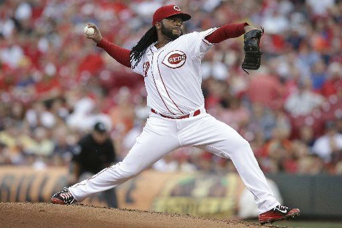 Cincinnati Reds starting pitcher Johnny Cueto (47) throws in the second inning of a baseball game against the Detroit Tigers, Wednesday, June 17, 2015, in Cincinnati. The Reds won 8-4. (AP Photo/John Minchillo)