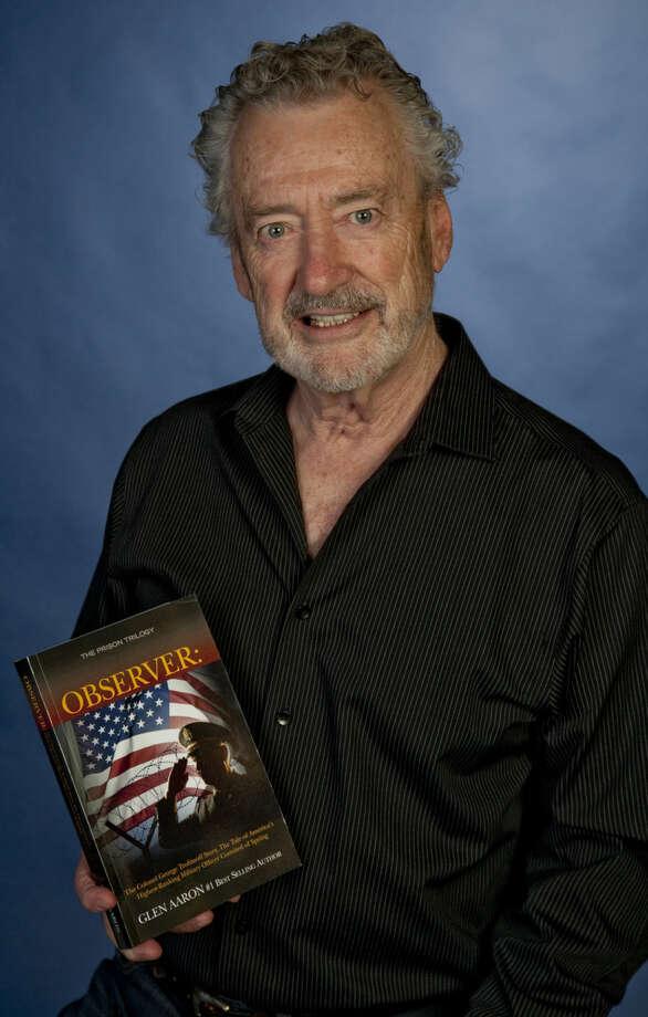 Glen Aaron displays his new book, Observer, Tuesday, 6-2-15. Tim Fischer\Reporter-Telegram Photo: Tim Fischer