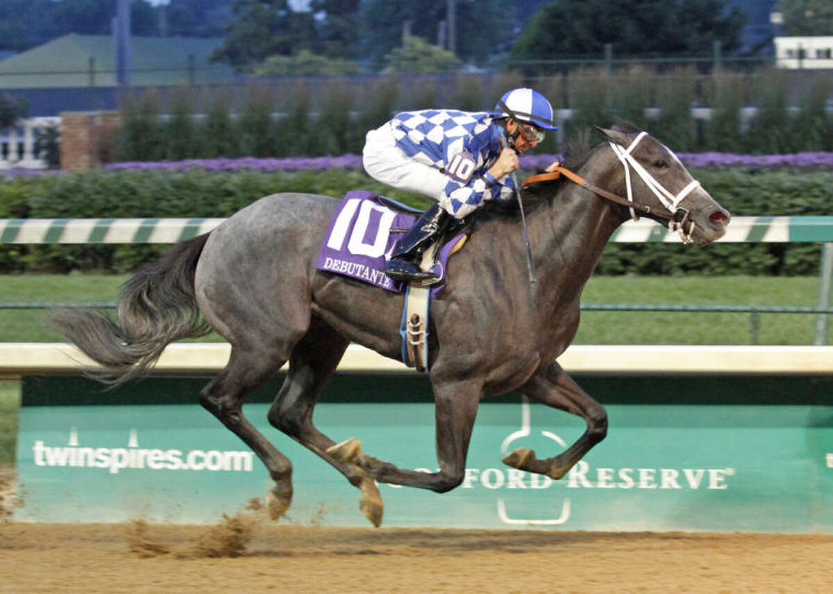 Fiftyshadesofgold is seen here winning the Debutante Stakes at Churchill Downs earlier this year. The 2-year old filly also won a recent stakes race at Lone Star Park in Grand Prairie. The horse is owned by Clarence Scharbauer Jr. Courtesy photo