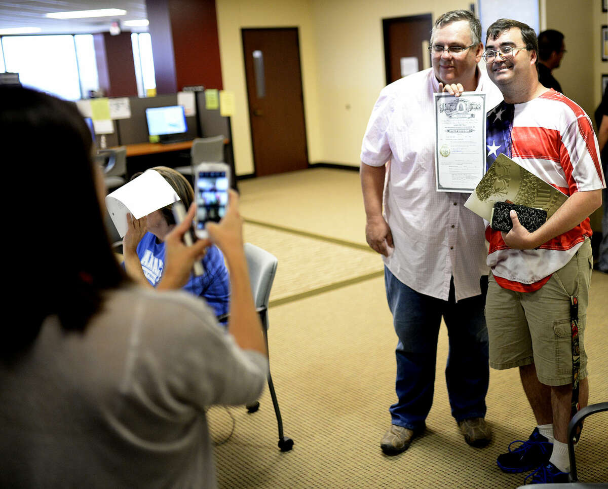 Ron Reid (left) and Chris Crawford (right) fill out paperwork to receive their marriage license on Friday, June 26, 2015 at the Midland County Courthouse. James Durbin/Reporter-Telegram