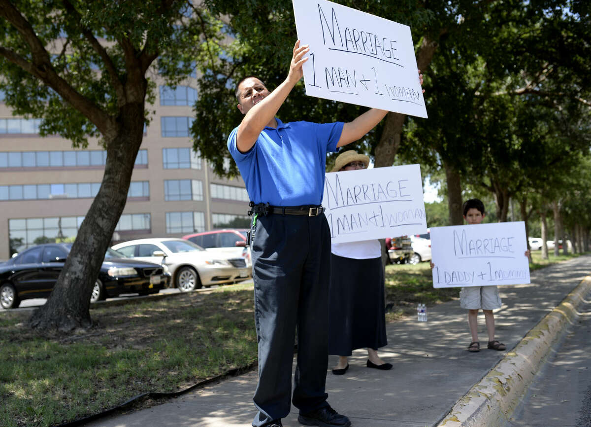 Protestors hold signs to speak out against the legalization of same-sex marriage, Friday, June 26, 2015 at the Midland County Courthouse. James Durbin/Reporter-Telegram