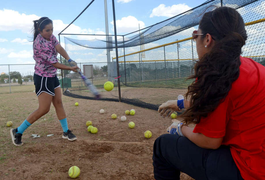 Midland Christian softball players Desiree Gaona (left) and Adrianna Berzoza (right) run through a hitting drill during team practice Wednesday at Freddie Ezell Softball Complex. The Midland Christian softball team heads to the state tournament this weekend. James Durbin/Reporter-Telegram Photo: James Durbin