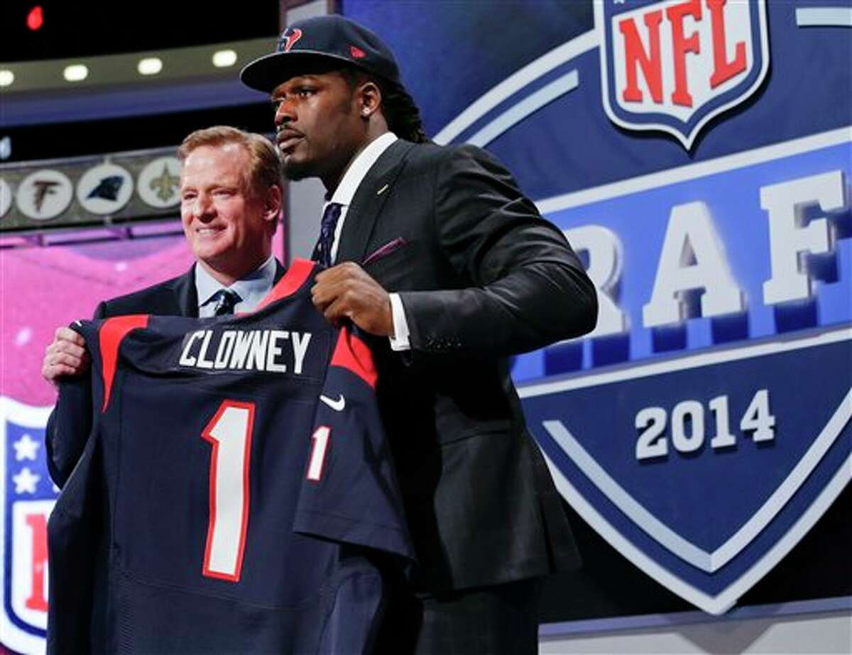 South Carolina defensive end Jadeveon Clowney holds up the jersey for the Houston Texans first pick of the first round of the 2014 NFL Draft with NFL commissioner Roger Goddell, Thursday, May 8, 2014, in New York. (AP Photo/Craig Ruttle)