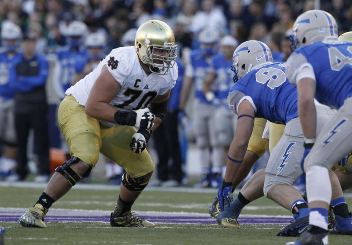 FILE - In this Oct. 26, 2013, file photo, Notre Dame offensive tackle Zack Martin looks to block against Air Force during the third quarter of an NCAA football game at the Air Force Academy, Colo. Martin was selected in the first round, 16th overall, by the Dallas Cowboys in the NFL draft on Thursday, May 8, 2014. (AP Photo/David Zalubowski)