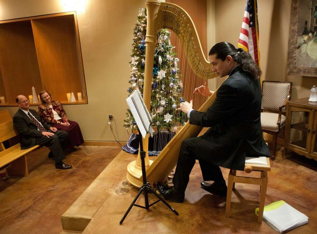 (File Photo) Ricky Rasura entertains guest with holiday music Thursday during the Midland College's annual Holiday Evening. Cindeka Nealy/Reporter-Telegram