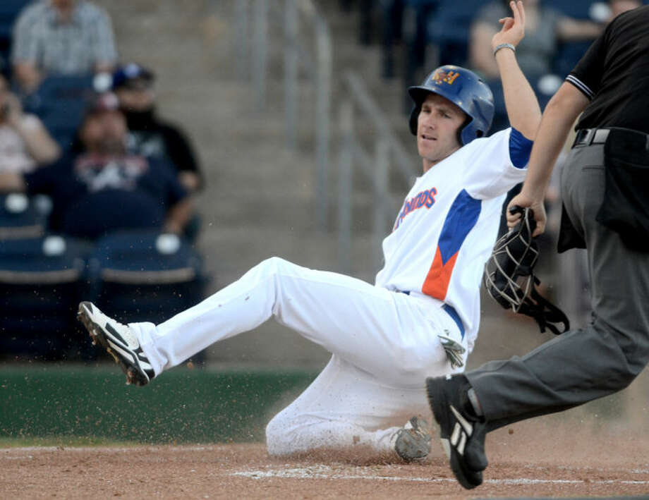 Rockhounds' Dusty Coleman slides into home to score against San Antonio on Thursday at Security Bank Ballpark. James Durbin/Reporter-Telegram Photo: James Durbin