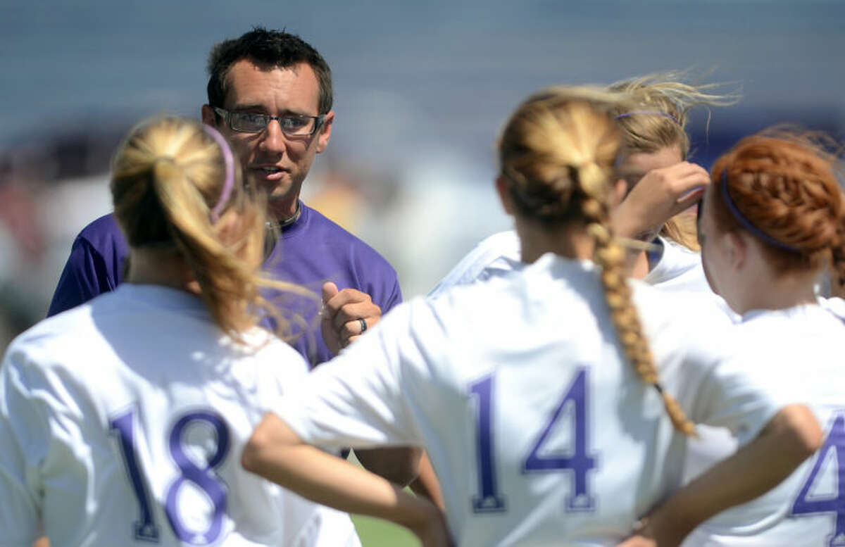 Midland High girls soccer head coach Ryan Dunlevy talks to his players after a win against Lee High Saturday at Grande Communications Stadium. James Durbin/Reporter-Telegram