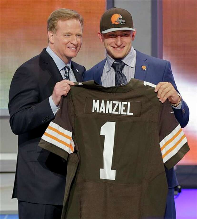 Texas A&M quarterback Johnny Manziel poses with NFL commissioner Roger Goodell after being selected by the Cleveland Browns as the 22nd pick in the first round of the 2014 NFL Draft, Thursday, May 8, 2014, in New York. (AP Photo/Frank Franklin II) Photo: Frank Franklin II / AP