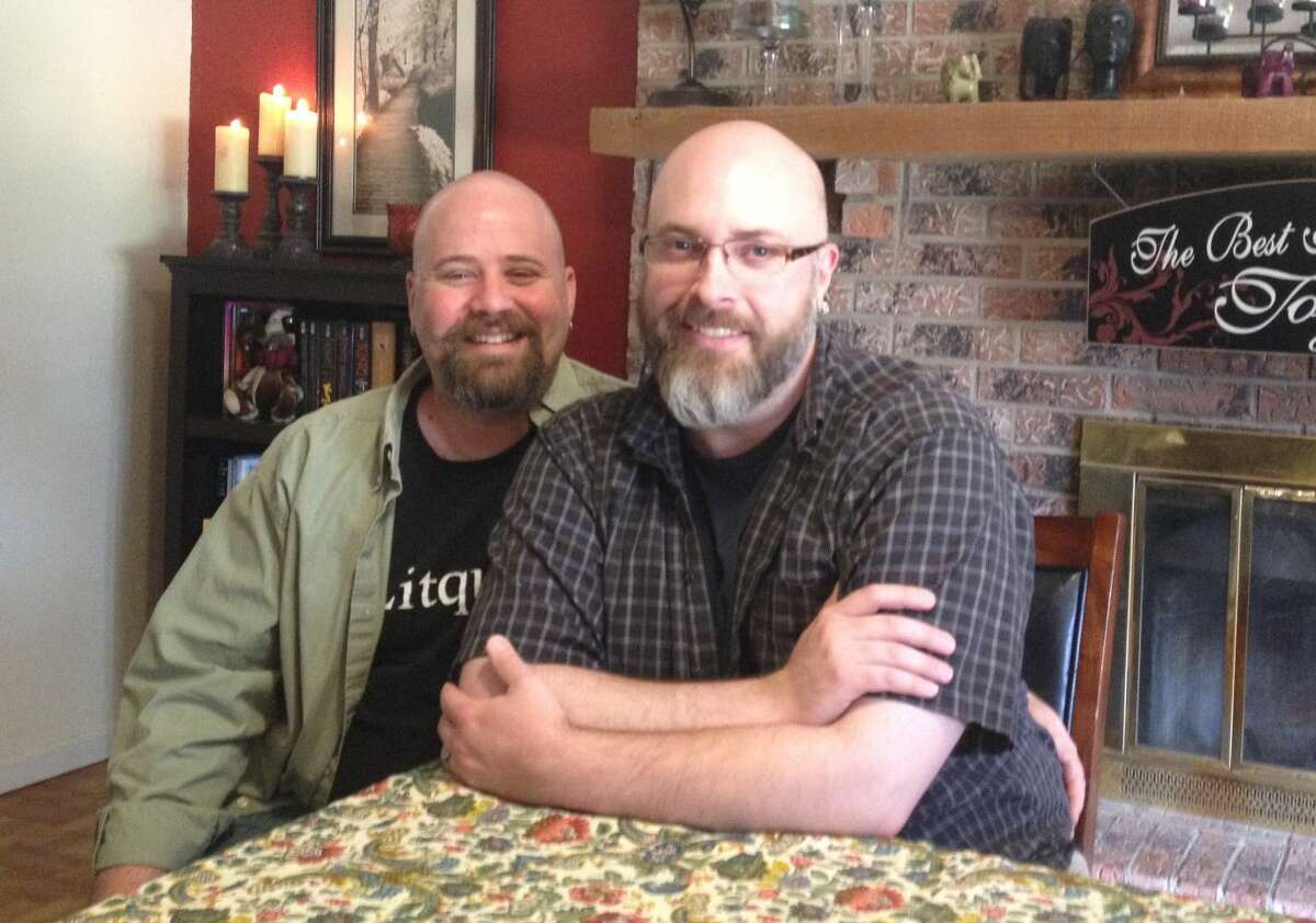 James, left, and Micheal Willhelm-Waid in their home. The two sat with the Reporter-Telegram to answer questions about the recent SCOTUS decision.