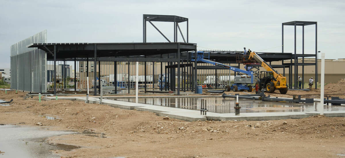 Construction continues Tuesday, 6-30-15, on the Red Oak Plaza, near Sams Club off Loop 250. Tim Fischer\Reporter-Telegram