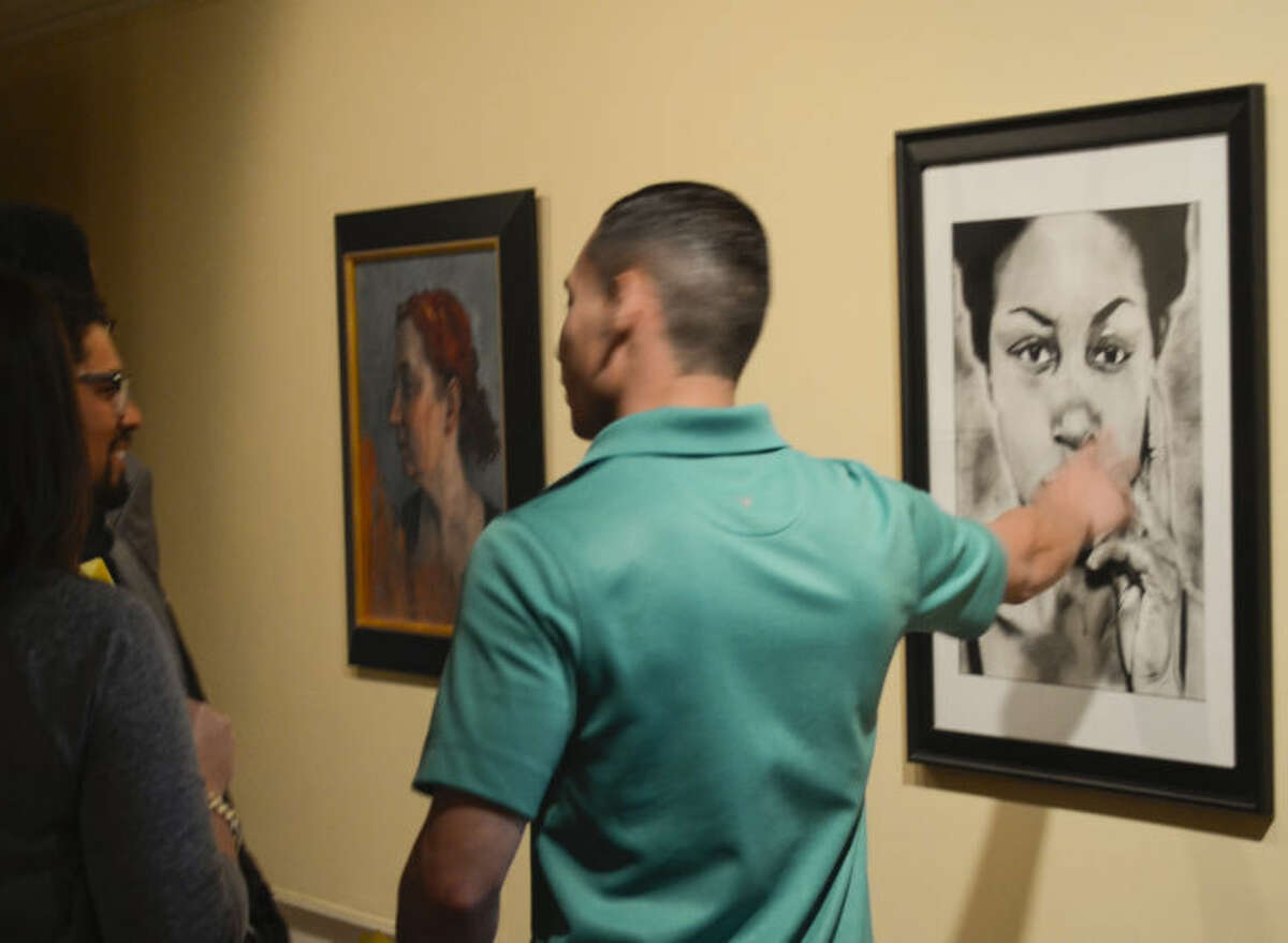 Patrons look at the artwork at the Midland Arts Association Texas Artists Today opening at Museum of the Southwest. Tim Fischer\Reporter-Telegram