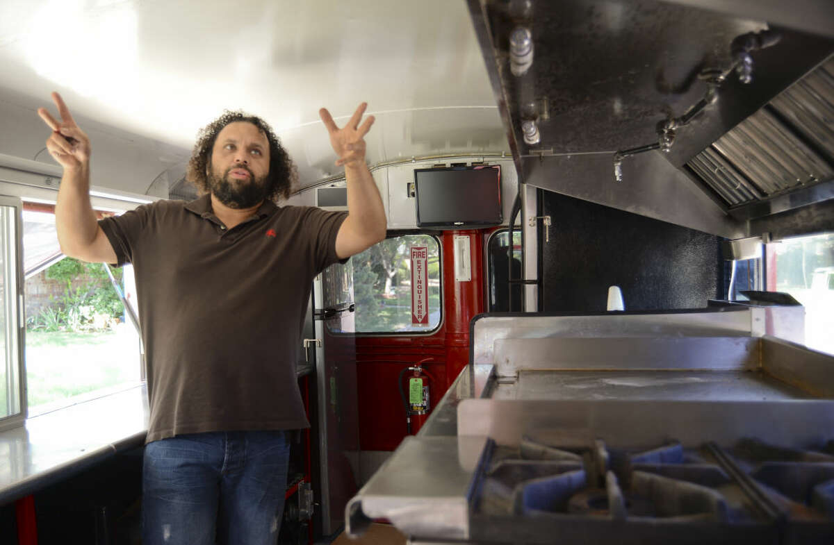 Sonny Aguilar talks about converting a British double decker bus into Bus 22, a new food truck with kitchen on the bottom and seating on the enclosed top deck Monday, 6-29-15, that will premier Saturday at the July 4th celebration at Hogan Park. Tim Fischer\Reporter-Telegram