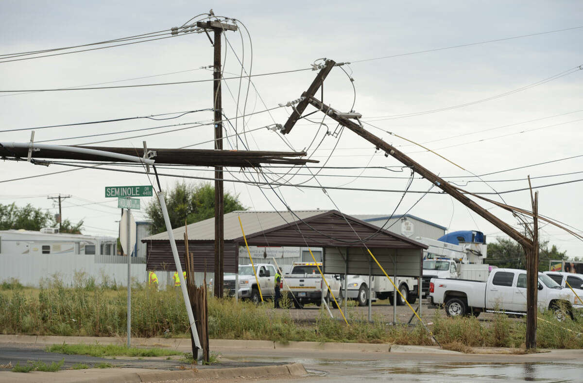 Storms that blew through early Tuesday, 6-30-15, knocked down power poles near the intersection of S. Midland Dr. and Seminole Dr. leaving many businesses and homes without power. Tim Fischer\Reporter-Telegram