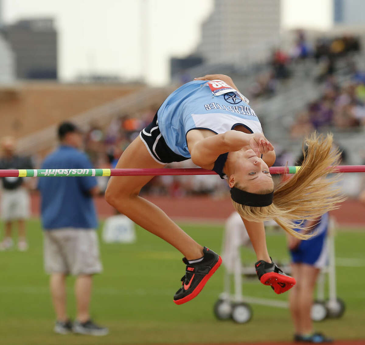 Greenwood's Morgan McKee clears the bar on the way to earning a silver medal at the UIL State Track and Field meet in Austin. McKee cleared 5 feet 6 inches to place second in her last trip to the state meet.
