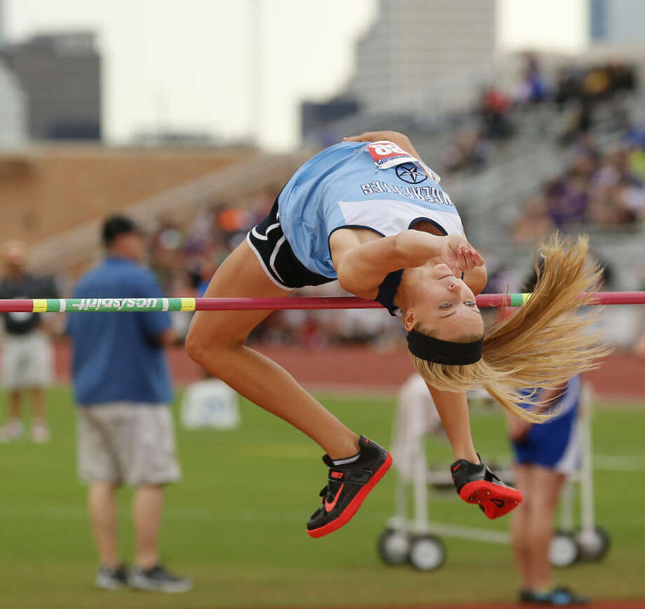Greenwood's Morgan McKee clears the bar on the way to earning a silver medal at the UIL State Track and Field meet in Austin. McKee cleared 5 feet 6 inches to place second in her last trip to the state meet. Photo: Wade H Clay