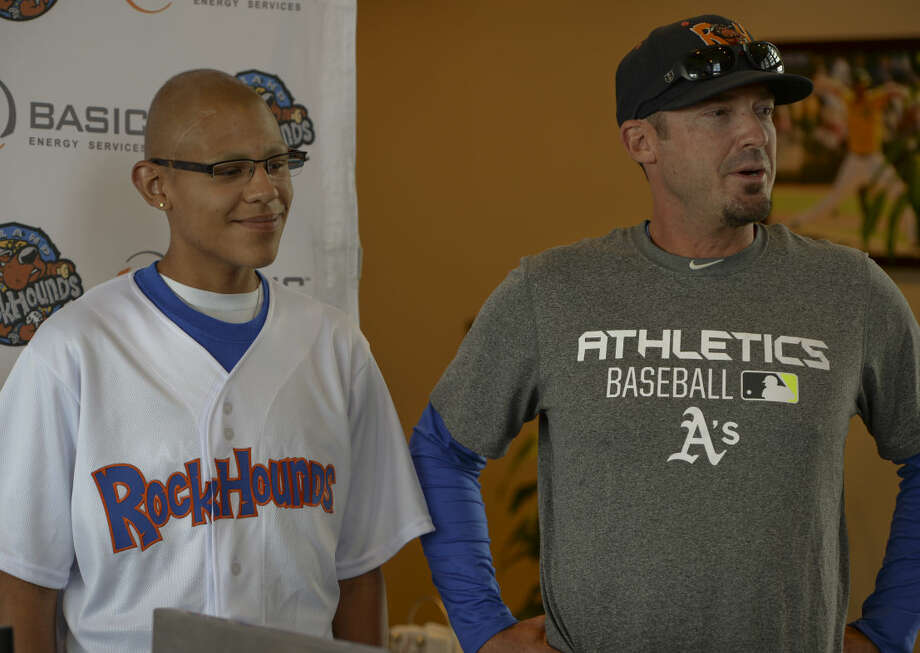 Marcelino Rodriguez, 15, is the newest player for the RockHounds Friday 7-3-15, as manager Ryan Christenson announces him as an official team member as part of his Make-A-Wish. Tim Fischer\Reporter-Telegram Photo: Tim Fischer