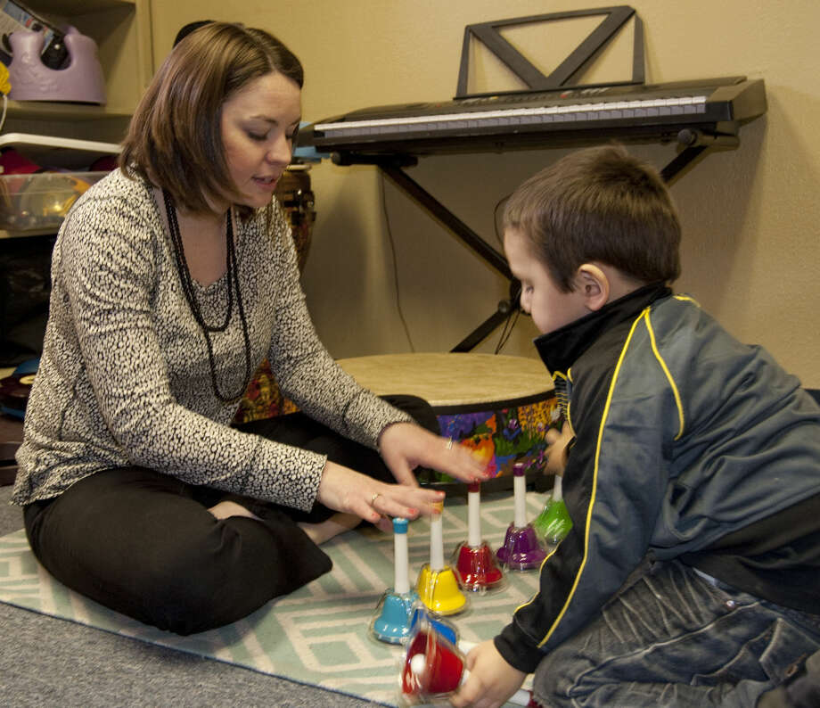 Kayla Minchew uses music with Demetrio Baeza as part of his therapy to learn and use new words. Tim Fischer\Reporter-Telegram Photo: MRT File Photo