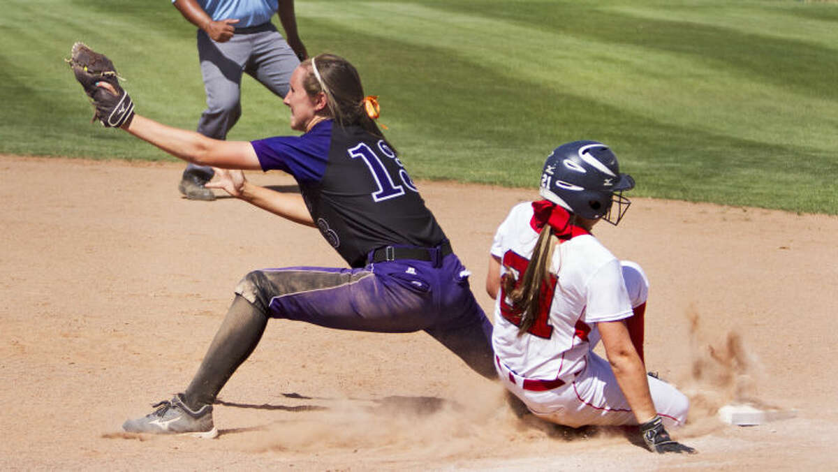 Midland first baseman Aubrie Elliott tags out Richland's Destiny Deaton at first base during the Bulldogs' 12-11 loss against the Rebels in the UIL Softball Regional Quarterfinals on Saturday at Plains Capital Park in Lubbock. The Bulldogs lost the series 2-1 to end their playoff run.