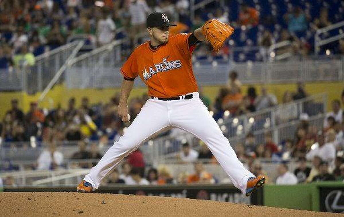 Miami Marlins starting pitcher Jose Fernandez (16) throws to the San Francisco Giants during the first inning of a baseball game in Miami on Thursday. (AP Photo/J Pat Carter)