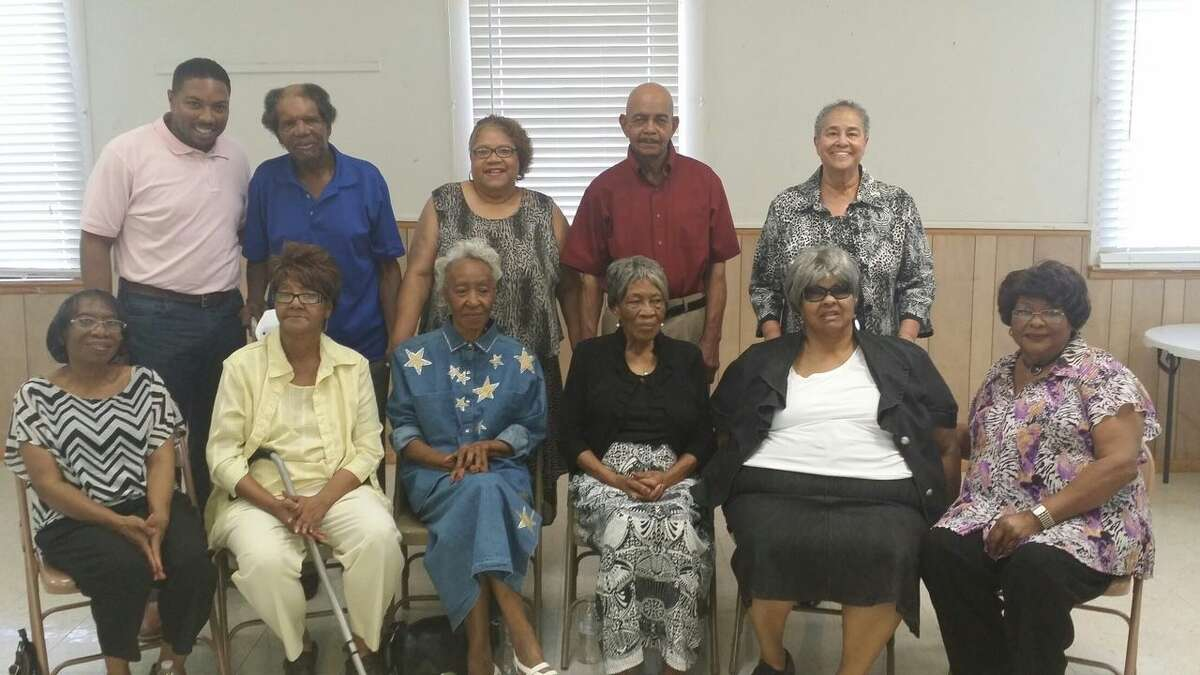 The Rev. Woodrow Bailey stands with several of Macedonia Baptist Church's longtime members June 25 at the church's fellowship hall.