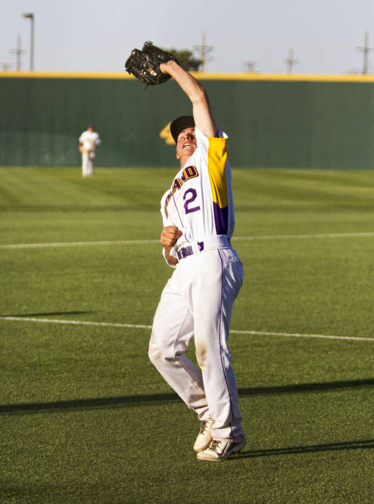 Midland pitcher Sean Grebeck catches a pop fly in the seventh inning during the Bulldogs' 9-5 victory against the Rebels in the UIL Baseball Area Championship on Friday at Hays Field in Lubbock.