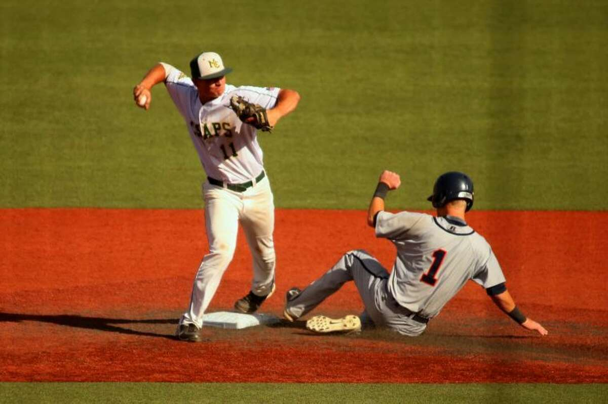 Midland College second baseman (11) looks to turn a double play against McLennan Community College during a Region V Tournament quarterfinal game at Rip Griffin Park on Saturday.