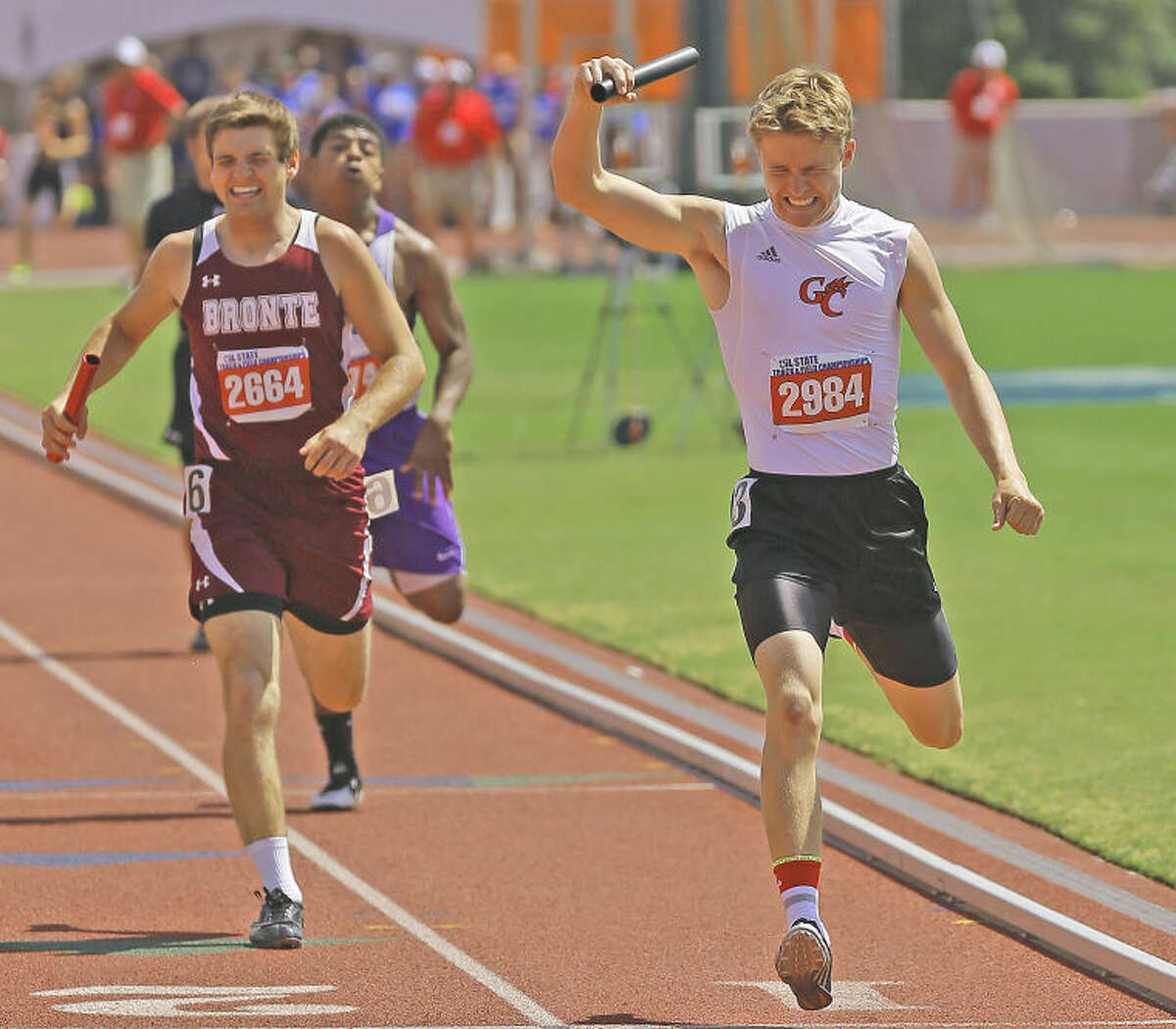 Garden City High School anchor Austin Odom triumphantly crosses the finish line to win the 800 relay in a time of 3:28.61.