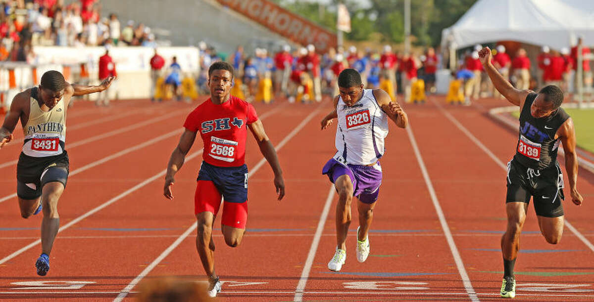 Midland High's De'Andre Goodley, second from right, is edged out for a medal during the Class 5A 100-meter dash Saturday at the UIL Track & Field Championships in Austin. Goodley ran in 10.45 seconds but just missed the medal stand by .01 second.