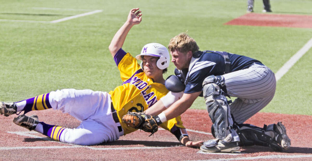 Midland's Bradon Scrivner tries to slide into home past Richland's catcher Carter Barke during the Bulldogs' 16-14 victory against the Rebels in the UIL Area Championship on Saturday at Hays Field in Lubbock. The Bulldogs won the series 2-1 to move onto the Regional Quarterfinals.