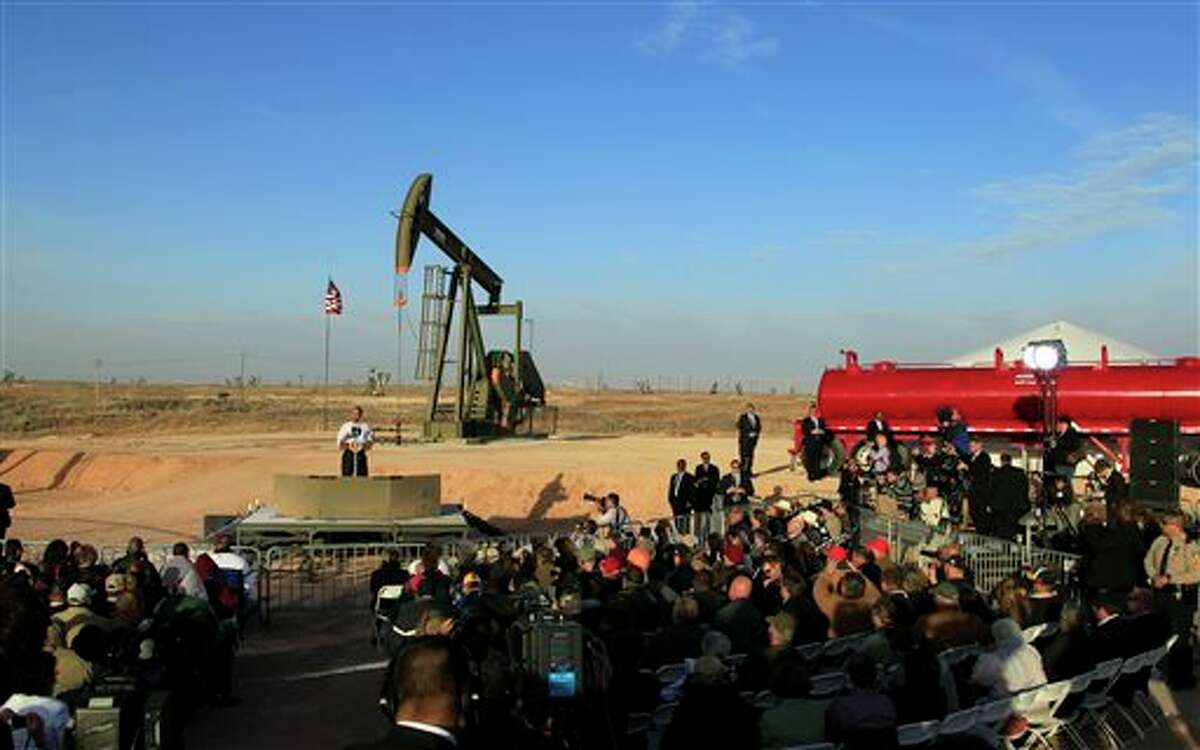 FILE - In this March 21, 2012, file photo, with oil pump jacks as a backdrop, President Barack Obama speaks at an oil and gas field on federal lands in Maljamar, N.M. The government has failed to inspect thousands of oil and gas wells it considers potentially high risks for water contamination and other environmental damage, congressional investigators say. The report, obtained by The Associated Press before its public release, highlights substantial gaps in oversight by the agency that manages oil and gas development on federal and Indian lands. (AP Photo/Ross D. Franklin, File)