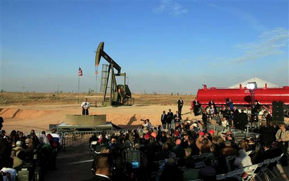 FILE - In this March 21, 2012, file photo, with oil pump jacks as a backdrop, President Barack Obama speaks at an oil and gas field on federal lands in Maljamar, N.M. The government has failed to inspect thousands of oil and gas wells it considers potentially high risks for water contamination and other environmental damage, congressional investigators say. The report, obtained by The Associated Press before its public release, highlights substantial gaps in oversight by the agency that manages oil and gas development on federal and Indian lands. (AP Photo/Ross D. Franklin, File) Photo: Ross D. Franklin / AP