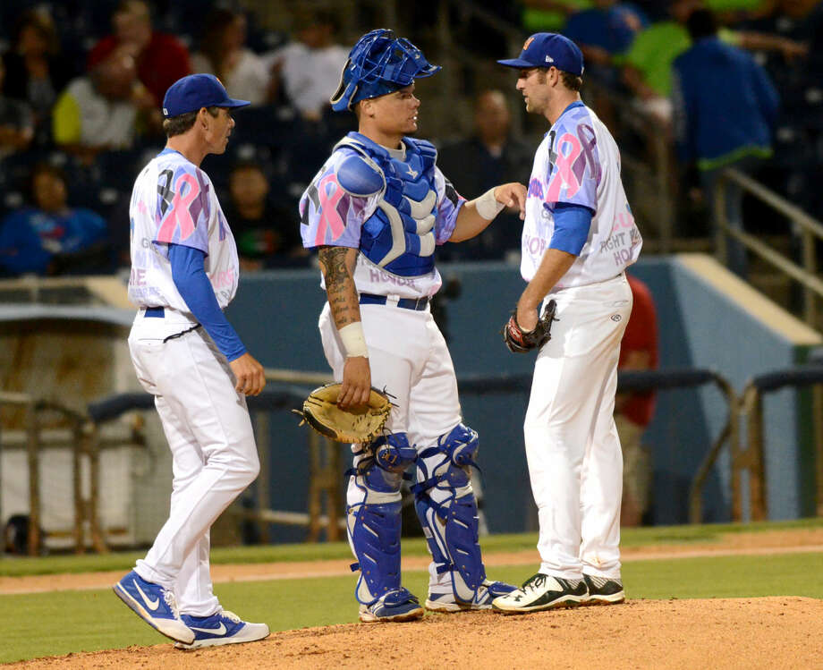 Rockhounds starting pitcher Chris Jensen (right) meets on the mound with catcher Bruce Maxwell (center) and pitching coach John Wasdin (left) during the game against Corpus Christi on Friday, June 12, 2015 at Security Bank Ballpark. James Durbin/Reporter-Telegram Photo: James Durbin