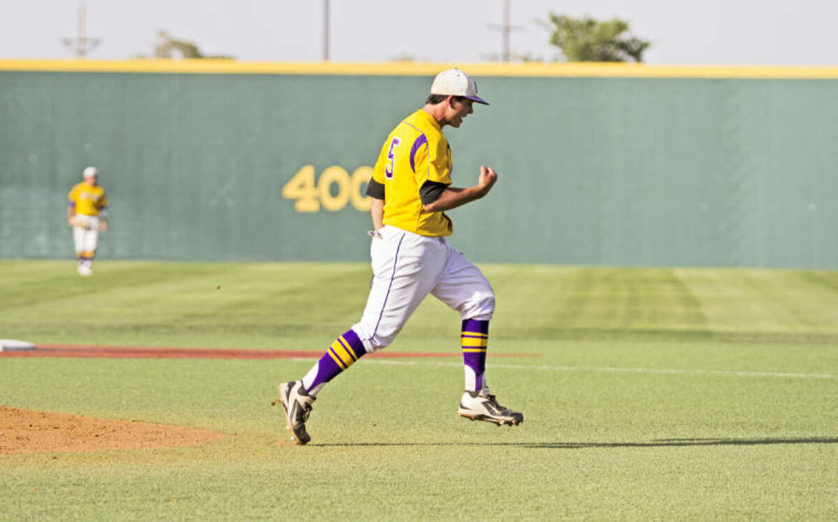 Midland pitcher Lance White after striking out the final batter of the game during the Bulldogs' 16-14 victory against the Rebels in the UIL Area Championship on Saturday at Hays Field in Lubbock. White received a save after finishing the game.