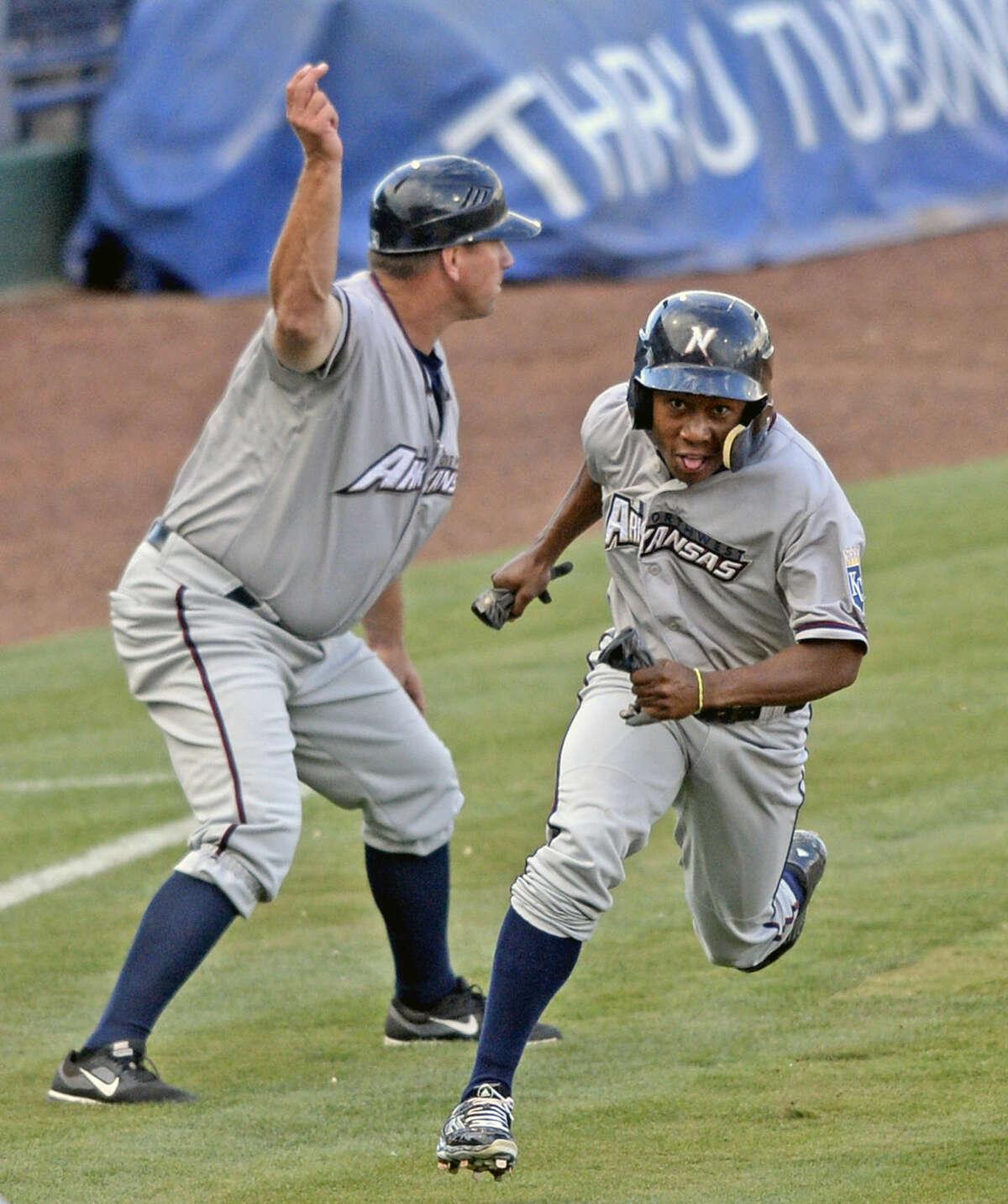 Northwest Arkansas' Terrance Gore scores against the Rockhounds on Tuesday, July 7, 2015, at Security Bank Ballpark. James Durbin/Reporter-Telegram