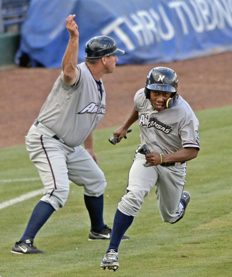 Northwest Arkansas' Terrance Gore scores against the Rockhounds on Tuesday, July 7, 2015, at Security Bank Ballpark. James Durbin/Reporter-Telegram Photo: James Durbin