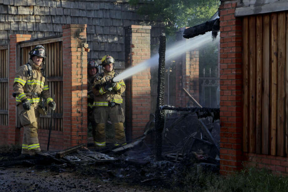 Firefighters extinguished a shed fire Monday night that damaged a nearby power line in the 1800 block of Ward Street. No one was injured in the blaze. Tyler White/Reporter-Telegram Photo: Tyler White