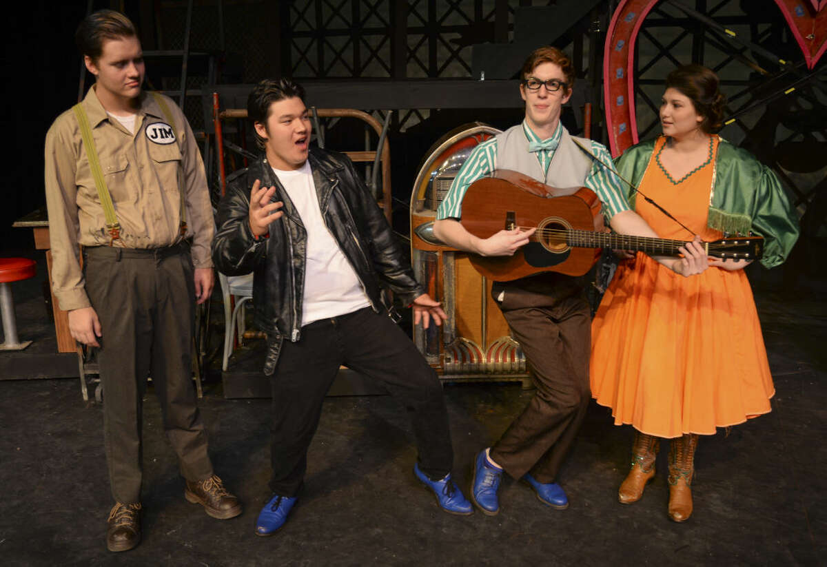 Dylan Watson as Jim listens as Jack Smith, Chad sings and Jamie Edge as Dennis, plays guitar and Kyle McDuffey as Sylvia listens during MCT's production of All Shook Up. Wednesday 7-1-15, Tim Fischer\Reporter-Telegram