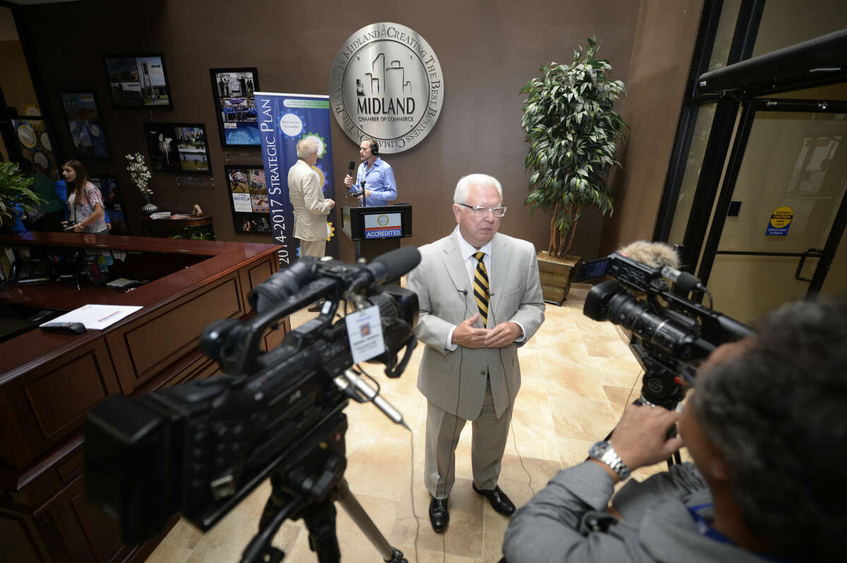 Bobby Burns, president of the Midland Chamber of Commerce, speaks to the media following a press conference Tuesday, July 7, 2015 in the Chamber offices to share the news that the Chamber was nationally accredited. James Durbin/Reporter-Telegram