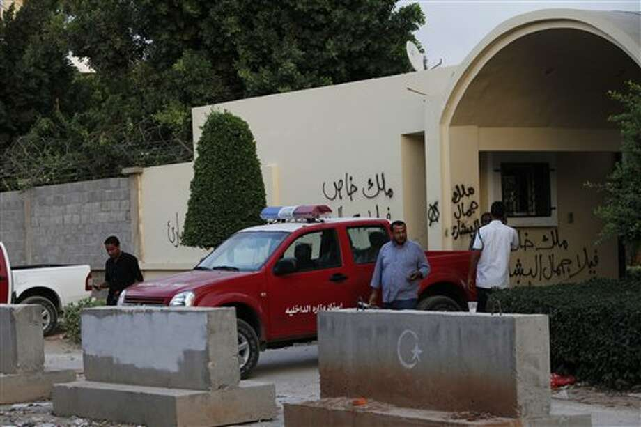 Libyan investigators leave the U.S. Consulate, in Benghazi, Libya Saturday, Sept. 15 2012 after finishing their investigation regarding the attack that killed four Americans, including Ambassador Chris Stevens on the night of Tuesday. The American ambassador to Libya and three other Americans were killed when a mob of protesters and gunmen overwhelmed the U.S. Consulate in Benghazi, setting fire to it in outrage over a film that ridicules Islam's Prophet Muhammad. Ambassador Chris Stevens, 52, died as he and a group of embassy employees went to the consulate to try to evacuate staff as a crowd of hundreds attacked the consulate Tuesday evening, many of them firing machine-guns and rocket-propelled grenades. (AP Photo/Mohammad Hannon) Photo: Mohammad Hannon / AP
