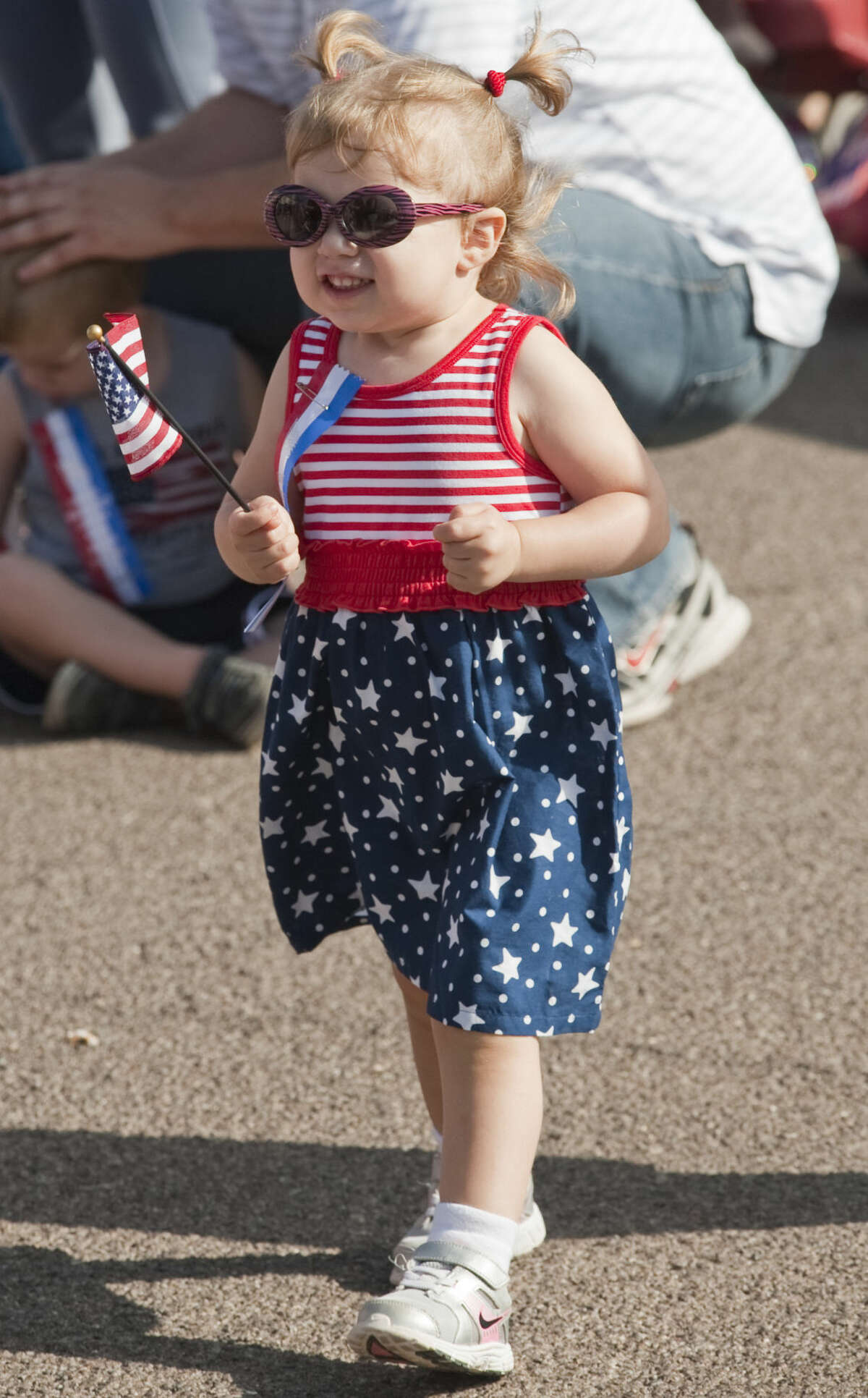 Delaney Blanton, 1 1/2 is excited as she and others get ready for the 2014 July 4th Children's Parade. Tim Fischer\Reporter-Telegram