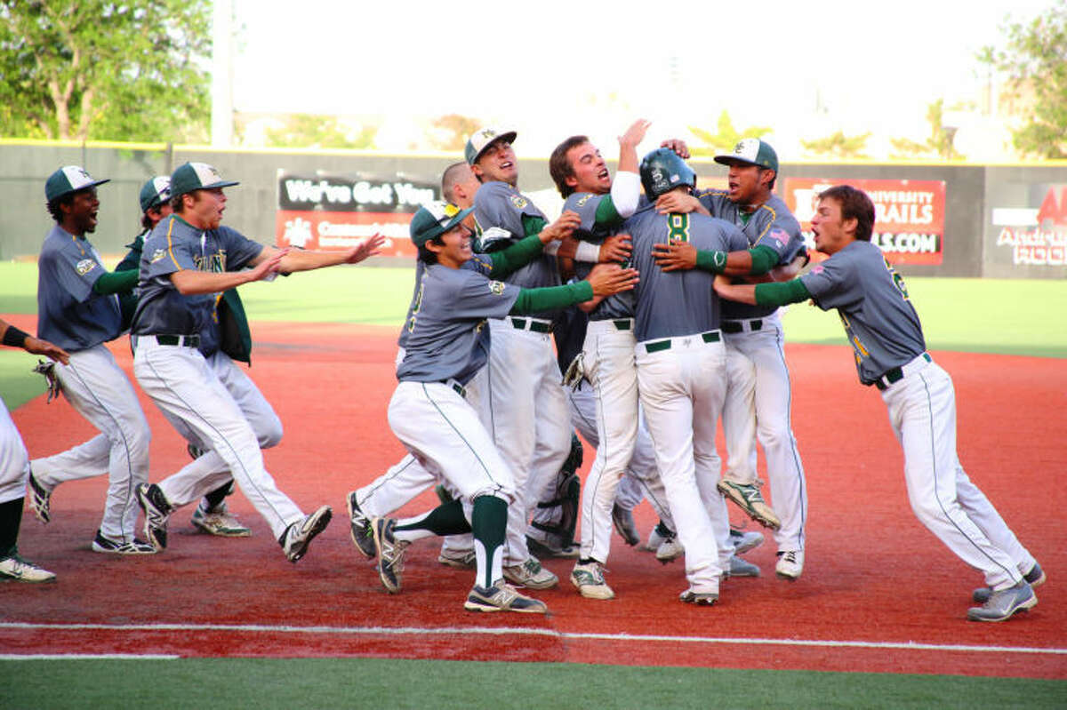 Midland College players mob Caleb Koedyker (8) after he hit a game-winning single in the bottom of the ninth inning to beat McLennan Community College 5-4 on Monday at the NJCAA Region V Baseball Tournament. Midla College will play MCC at 1 p.m. today and the winner will advance to the Juco World Series later this month in Grand Junction, Colo. Forrest Allen/MC Athletics