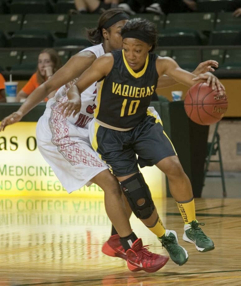 Central Arizona's Paris Webb, Midland High graduate, dribbles around Trinity Valley's Autummn Williams Thursday afternoon at the 4th annual Women's National Invitational Tournament at the Chaparral Center. Tim Fischer\Reporter-Telegram Photo: Tim Fischer