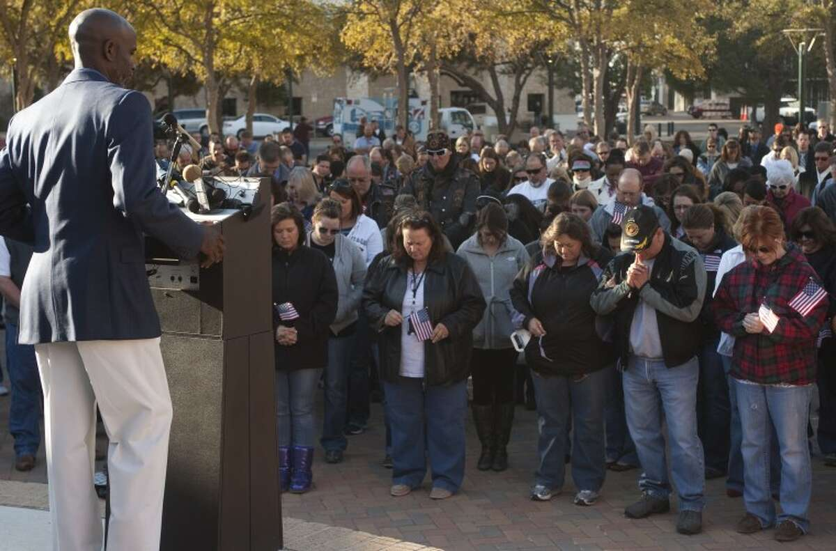 Pastor Roy Smith, with True Lite Christian Fellowship, leads hundreds of Midlanders and others in prayer Friday morning during a prayer service for the victims and their families, as well as others involved in the veterans train crash Thursday afternoon. Tim Fischer\Reporter-Telegram
