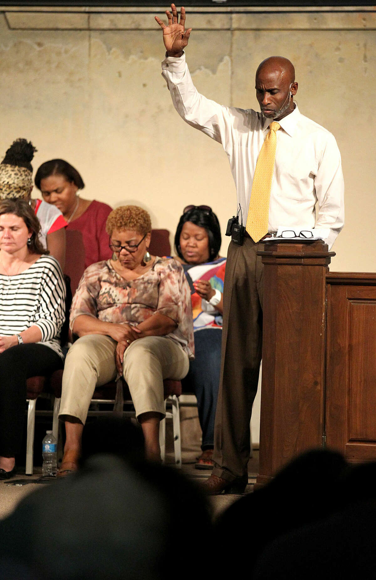 Rev. Roy Smith of True-Lite Christian Fellowship speaks during a prayer gathering Wednesday, July 1, 2015, to honor the victims of the Charleston shooting and discuss ways to unite the city. James Durbin/Reporter-Telegram