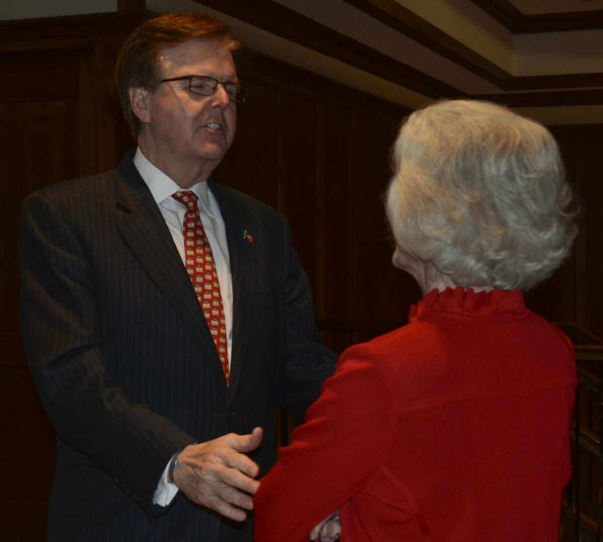 Dan Patrick talks with Judy Canon Wednesday at the Midland County Republican Women's luncheon at Midland Country Club. Tim Fischer\Reporter-Telegram